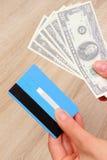 Waluta dolar i kredytowa karta w ręce, finansowy pojęcie Obrazy Royalty Free