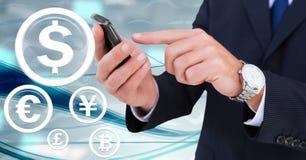 Waluta okręgu szklane ikony i ręki trzyma telefon Zdjęcie Royalty Free