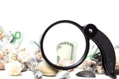 Waluta pod powiększać - szkło Obraz Royalty Free