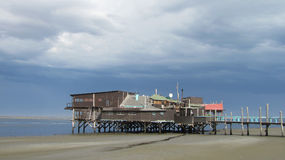 Walvis Bay Lagoon. The Raft Restaurant at Walvis Bay's Lagoon set against a stormy sky, Namibia, Africa stock photo