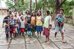 Wamena, Indonesia - January 9, 2010: People of the Dani tribe in a usual dress standing in Dugum Dani Village. Baliem Valley Papua. Irian Jaya, Indonesian New royalty free stock photos