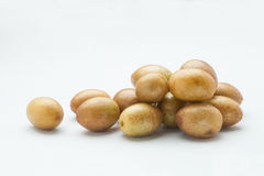 Wampee fruit. Fresh wampee fruit on white background. Wampee fruit is a tropical fruit native to southern China Stock Images
