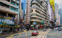 Wan Chai street, Hong Kong. Traffic and pedestrians on Wan Chai Road, Hong Kong stock photos