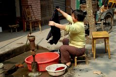 Wan Jia, China: Woman Doing Laundry Stock Images