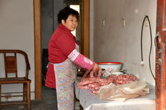 Wan Jia, China: Woman Making Sausages Royalty Free Stock Photos