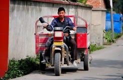 Wan Jia Village, China: Farmer Driving Along Roadway Stock Image