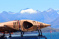 Wanaka - New Zealand. Kayaks against snow cap mountains of Mount Aspiring National Park and Wanaka lake in the Otago region of the South Island of New Zealand Royalty Free Stock Photography