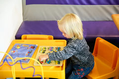 Wanaka, New Zealand - Febr 5, 2015: little girl playing in the cafe of Puzzling world Stock Photo