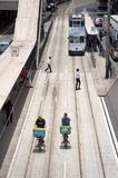 Bicycle delivery men riding along the tram tracks in the Wanchai District of Hong Kong Island Stock Image