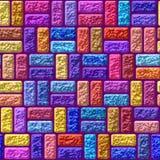 Wand bestanden aus farbigem Ziegelstein Stockfotos