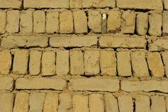 Wand der Lehm-Ziegelsteine Stockbild