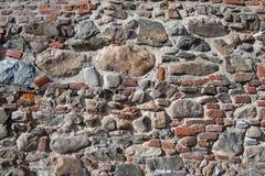 Wand der Ziegelsteine und der Steine als Beschaffenheit Lizenzfreie Stockfotos