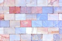Wand des Marmors Ungewöhnliche Steinbeschaffenheit Hintergrund der Fliesen Lizenzfreie Stockfotos