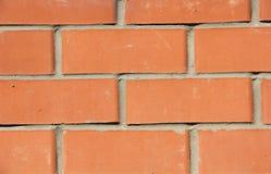 Wand des roten Backsteins, Hintergrund Stockfotos