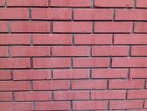 Wand des roten Backsteins - Hintergrund Lizenzfreie Stockfotografie