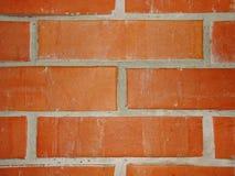 Wand des roten Backsteins mit Lehmmörserfragment von Maurerarbeitholzofen Stockbilder