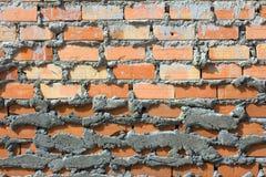 Wand des roten Backsteins, orange Stockfotografie