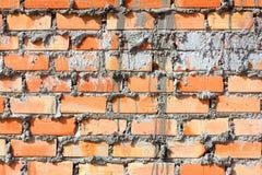 Wand des roten Backsteins, orange stockfotos