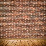 Wand des roten Backsteins und Bretterbodenhintergrund Stockbild