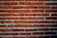 Wand des roten Backsteins und des Zementes Stockfoto