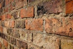 Wand des roten Backsteins vom Winkel Lizenzfreie Stockfotos