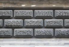 Wand errichtet von den grauen Ziegelsteinen Bunte Auslegung des Strudels stockfotografie