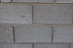 Wand hergestellt von den großen grauen Betonblöcken stockbild