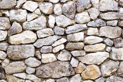 Wand hergestellt von den Steinen der unregelmäßigen Form Stockbild