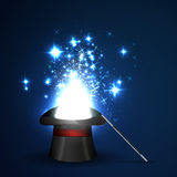 Wand and magical hat. Background glowing wand and magical hat Royalty Free Stock Photo