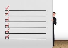 Wand mit Checkliste stockbild