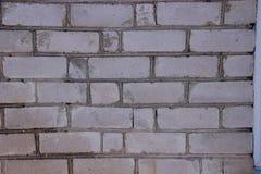 Wand mit Maurerarbeit Graue Ziegelsteine stockbild