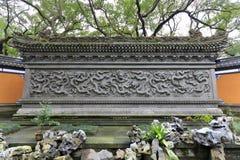 Wand mit neun Drachen im Putuoshan-Insel-Naturschutzgebiet, luftgetrockneter Ziegelstein rgb Stockfotos