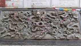 Wand mit neun Drachen im Tempel Lizenzfreie Stockfotos
