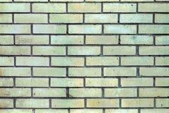 Wand mit Sand-farbigen Ziegelsteinen Lizenzfreie Stockbilder