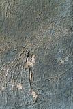 Wand mit Schale befleckte graues Farbenbeschaffenheitsfoto Lizenzfreies Stockfoto
