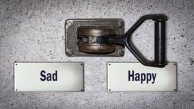 Wand-Schalter zu glücklichem gegen trauriges stockfotos