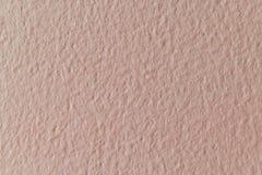 Wand tapeziert und mit Farbenbeige oder Aprikosenfarbe gemalt Stockbilder