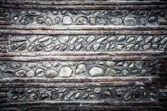 Wand von alten Ziegelsteinen und von Steinen Strukturierter Hintergrund getont Stockbild