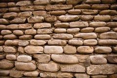 Wand von alten Ziegelsteinen und von Steinen Strukturierter Hintergrund getont Stockbilder