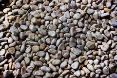 Wand von glatten Steinen Stockbilder