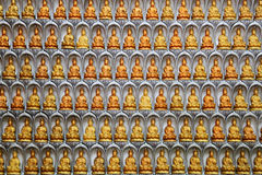 Wand von Guan Yin Statuen Stockfotos