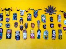 Wand von Masken Stockfotografie