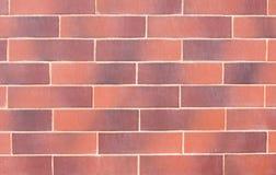 Wand von roten dekorativen Ziegelsteinen stockfotos