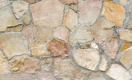 Wand von Steinen als Beschaffenheit und Hintergrund Lizenzfreies Stockfoto