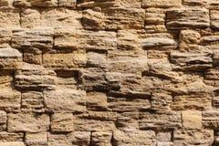 Wand von Steinen, Hintergrund in Form einer Wand lizenzfreies stockbild