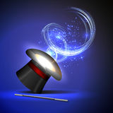 Wand and wizard hat. Background wand and magical glow Royalty Free Stock Photography