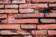 Wandbeschaffenheit des roten Backsteins der Nahaufnahme alte Stockfotografie