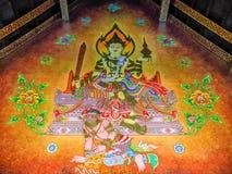 Wandbild des Gottes sitzend über thailändischem Riesen Stockfoto