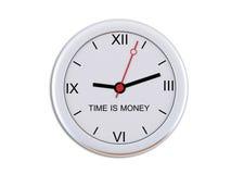 Wandborduhr mit der Beschreibung Zeit ist Geld Lizenzfreies Stockbild