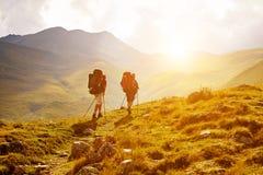 Wandelaars in de Bergen Stock Foto